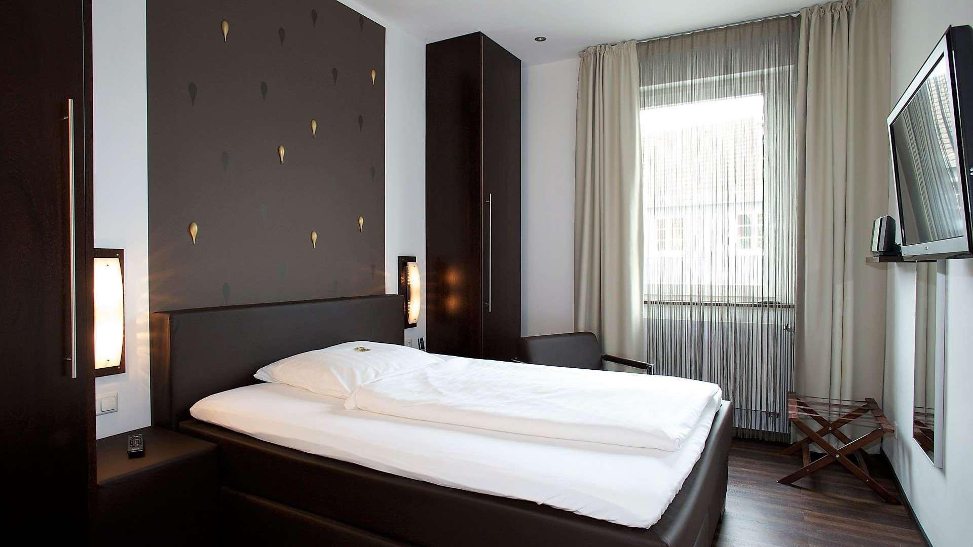 Einzelzimmer Komfort mit King Size Bett